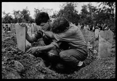 """<b>1993. Outside Brcko.</b><br><br>""""In a small Bosnian village outside the town of Brcko, what had once been a park became a cemetery. All of the able, young men in the village were called upon to defend their families and homes from constant attacks by the Serbian army. Battlefield casualties were brought to the local mosque where the villagers would discover which of their relatives or neighbors had died that day.<br><br>The young Bosnian soldier who guided me to the cemetery said that all…"""