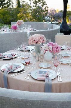Blush and grey modern feminine table setting for a wedding.