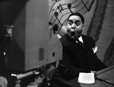 "Thomas Wright ""Fats"" Waller (May 21, 1904 – December 15, 1943) was an influential American jazz pianist, organist, composer, singer, and comedic entertainer, whose innovations to the Harlem stride style laid the groundwork for modern jazz piano, and whose best-known compositions, ""Ain't Misbehavin'"" and ""Honeysuckle Rose"", were inducted into the Grammy Hall of Fame posthumously, in 1984 and 1999."