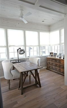 desk for two and small space.  I wish I could find something like this.  Love the wood used...and the floors in this house.