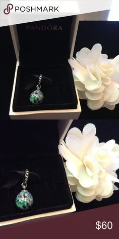 Pandora blue/purple egg dangle charm authentic. This Pandora charm is hard to find, it has green, purple, blue and white specks.. NWOT.. This dangle egg charm matches the tropical fascinating charm perfectly.. Sterling silver and porcelain .this charm only will come with a Pandora cardboard box with tissue and sticker. Box shown is not included.. Thank you.. All my charms are authentic Pandora Jewelry