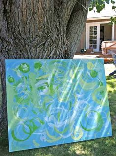 Great idea. This person found a cheaply priced UGLY framed print and bought anyway. She painted the canvas and then had her kids paint over it. A new frame & canvas would have cost more. ... I could use something fun like that for our downstairs family room!