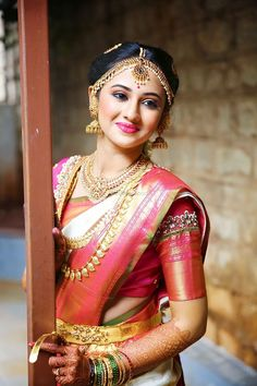 Pretty dewy South Indian makeup with pink lipstick for wedding. See more on wedmegood.com #wedmegood #indianwedding #makeup #makeupartist #southindianbride #southindianweddings #jewellery #southindianjewellery #jewelry #bridalmakeup #pink #pinklipstick #kanjivaram #kanjivaramsaree #sari #saree #templejewellery