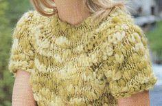Torna di moda il raglan con questa graziosa maglia a mezza manica, da realizzare ai ferri in maglia rasata con una lana speciale.