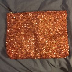Nwot Marciano Pink Sequin Clutch bag I received this bag as a gift for Christmas and I never ever used it. It's light pink and sparkly has a gold zipper closure and a smaller zip compartment inside. could also be used as a cosmetic bag as well Marciano Bags Clutches & Wristlets