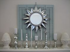 Dishfunctional Designs: Upcycled: New Ways With Old Window Shutters. Just took off the last set of shutters from out windows.need a DIY idea like this Old Window Shutters, Diy Shutters, Repurposed Shutters, Blue Shutters, Window Frames, Sunburst Mirror, Diy Mirror, Wall Mirror, Shutter Decor