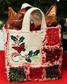 Free project instructions to make an embroidered rag quilt Christmas gift bag