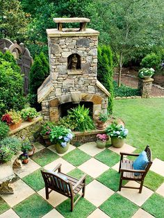 Patio Landscaping Ideas.  A visually arresting motif forms the floor of this patio.  -- Whimsy meets practicality in this playful pattern that mixes squares of grass with pavers.  -- A fireplace offers a focal point and a backdrop to the patio.  -- A patio can also naturally extend into a grassy space; definition of edges comes thanks to stone edging and columns.  -- A wall of stacked stones offers a spot for a collection of colorful containers.