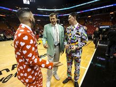 """""""I wasn't even alive when he started wearing his jackets like this"""", Sean Baum said of Craig Sager. He and friend Moody Hammed(left) dressed in bright suits at the Miami Heat game to honor Sager. They are big fans of his. Sager admires the outfits when the guys asked for a photo with him. He worked the Chicago Bulls at Miami Heat game on Thursday, April 7, 2016.  (Photo: Andrea Melendez/The News-Press)"""
