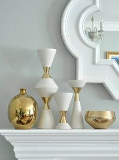 white and gold vases on mantle