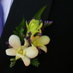 Three White and Green Dendrobium Blossom Boutonniere with Purple Statis and Green Wire.  needs a little more purple