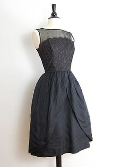 $128  Vintage 1950s formal dress with illusion top. Lace has a slight maroon tint of color. The skirt is my favorite! It splits off into two parts, so chic! There is a tiny area in the back where the sheer fabric fibers tore apart.