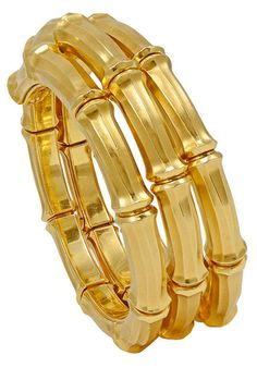 *Cartier Gold Bamboo Bracelet, Fabulous flexible Bamboo pattern bracelet. Made, signed and numbered Cartier. Heavy gauge 18K gold, with deep brilliant gold color. A most chic and distinctive piece of jewelry. This bracelet is outstanding.