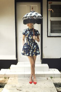 modern cheongsam by Ong Shunmugam love the design on the dress the shoes and the umbrella