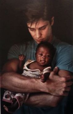 roberto bolle in an ad for unicef. i love this photo so much.