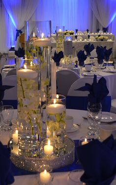 Cylinder trio with floating candles with submerged callas and dendrobium orchids. Royal Blue Wedding Decorations, Blue Wedding Centerpieces, Quince Decorations, Reception Decorations, Royal Blue Weddings, Wedding Themes, Wedding Colors, Royal Blue Bridesmaids, Wedding Ideas