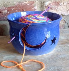 Small blue yarn bowl with Stars  Moon cut out design.   Available from Earth Wool  Fire.
