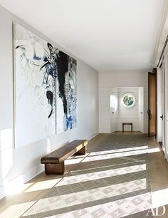 The entrance hall is graced with a diptych by Suzanne McClelland, displayed above a bench designed by Zanini de Zanine Caldas for Espasso; the rug is by Stark.