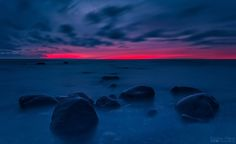 Dramatic blue and red long exposure photo of sunset in Varbla beach. Estonia 2016  #sunset #estonia #water #seascape #landscape #sea #beach #clouds #dramatic