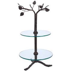 "Two-tiered metal and glass tray with a tree silhouette.        Product: Tray  Construction Material: Glass and metal  Color: Natural  Features:   Two glass shelves  Tree-inspired silhouette  Dimensions: 29"" H x 13"" Diameter     Note: Not recommended for outdoor use   Cleaning and Care: Wipe with dry cloth."