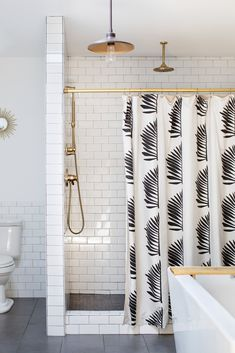 The shower curtain is custom made by Suite 33.