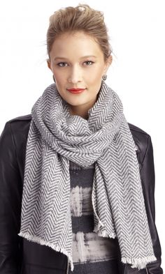 100% cashmere, herringbone-printed scarf. So cozy and cool.