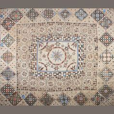 A very large early 19th century cotton chintz patchwork quilt