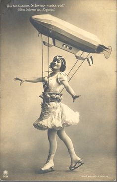 """Vintage postcard: """"Berlin's Admirals-palast Ice Arena hosted a variety of lavish ice ballet in the with fantastical costumes, including this """"Zeppelin Girl"""""""" Vintage Versace, Vintage Dior, Vintage Vogue, Vintage Glamour, Zeppelin, Vintage Photographs, Vintage Images, Vintage Posters, Costume Halloween"""