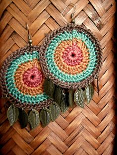 Crochet cyclic earrings adorned with leaves