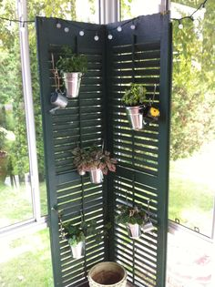 Planter made out of two antique shutters.