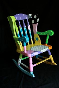Colorful and unique rocking chair for sale.  Gorgeous colors and design.  One-of-a-kind piece of art.
