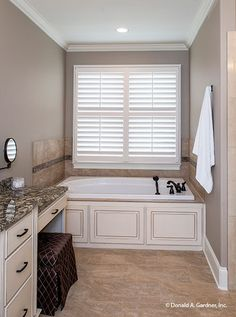 A large soaking bathtub complements this master bathroom. The Spotswood - Plan 1310. http://www.dongardner.com/house-plan/1310/the-spotswood. #MasterBathroom #GardenTub #FloorPlan