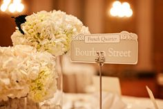 Table names with significance to the couple - A Pink New Orleans Wedding by Stevie Ramos Photography