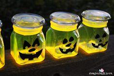 These Glow Stick Pumpkin Jars will be the talk of the neighborhood on Halloween night! via createcraftlove.com for The 36th Avenue #glowsti...