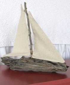 "I just drilled a hole in the branch, glued in the ""mast"", made little sails out of unbleached muslin and ""rigged"" them to the mast."
