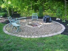 fire pit idea...love the bricks with the rock.  I would have different chairs