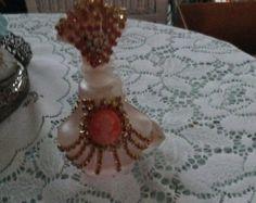 Jeweled pink rhinestone perfume bottle with cameo