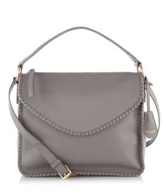 The Bowery Messenger is a luxury handbag crafted with a combination of soft cowhide and smooth Nubuck leather for a look that's as chic and sophisticated as Manhattan itself.