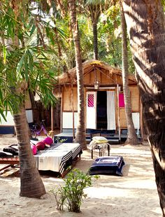 Images from Jade Jagger's beach house were published a couple of years ago but I still can't get over how amazing it is. Situated nearby the jewelry designer's seasonal boutique in Goa, this West Indian rental is adorned with the most charming details like hot pink textiles, a thatched roof,