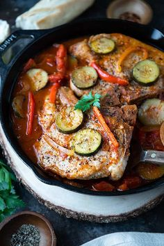 Easy Italian Pork Chops with tomatoes, red peppers, onion and zucchini cooked in ONE SKILLET for easy cleanup! A quick and delicious meal! #porkchops #onepan #easyrecipe