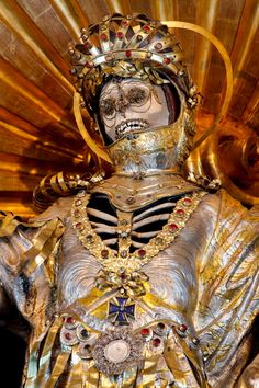 "The decorated skeleton of St. Maximus (Bürglen, Switzerland) ""He was believed to have been an Early Christian soldier who was martyred (hence the armour). He was decorated in the late 17th century and became associated with the legend of a feral white cat, which some believed was his ghost that prowled the village to check on its residents."""
