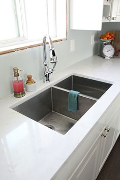 "The sink is a total of 30"" x 17""  and 10"" deep.  We went with a stainless split sink, about 2/3 is the main bowl and the side bowl is the remaining 1/3.  And it is all seamless.  I knew I wanted a deeper sink for washing large pots and pans and filling my mop bucket..."