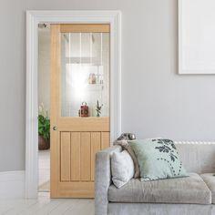 Single Pocket Mexicano Oak Door with Half Light Clear Glass and Frosted Lines - Lifestyle Image. #glazeddoor #pocketdoor