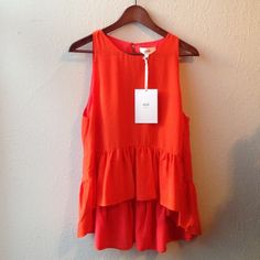 """Aijek ruffle blouse Bright orange blouse with high low ruffle at the bottom. Back is lower than the front. I am 5'3"""" and the back is tunic length on me. 100% silk. Aijek Tops Blouses"""