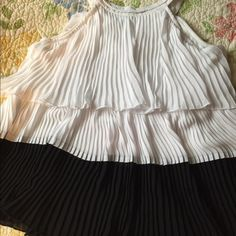 Electric pleated top-xoxo Combination of Black and white electric pleated layered top.Alter, size Xs. Chiffon material. XOXO Tops Blouses