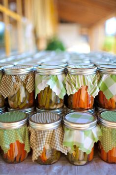 My mom canned when I was younger & I remember seeing fabric on some jars like this...