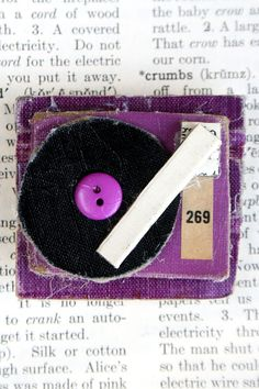"Record player brooch--if you ""Like"" this, you're probably giving away your age!"