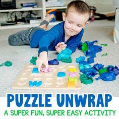 Puzzle Unwrap: A Fun Toddler Activity - Busy Toddler Toddler Learning, Fun Learning, Learning Activities, Toddler Games, Early Learning, Fun Activities For Toddlers, Puzzles For Toddlers, Nanny Activities, Preschool At Home