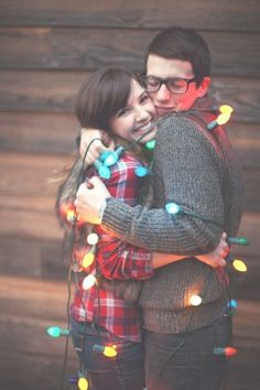 Idea for Christmas Photo Card Pose - wrap yourselves in Christmas lights!