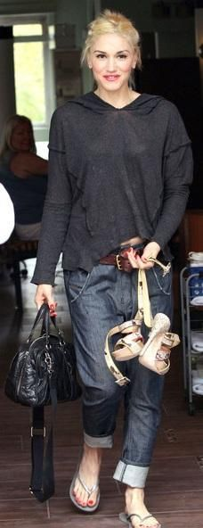 Who made Gwen Stefani's black handbag, denim pants, and gray flip flops that she wore in West Hollywood on April 2, 2011? Shoes – Havaiana  Purse and jeans – L.A.M.B.